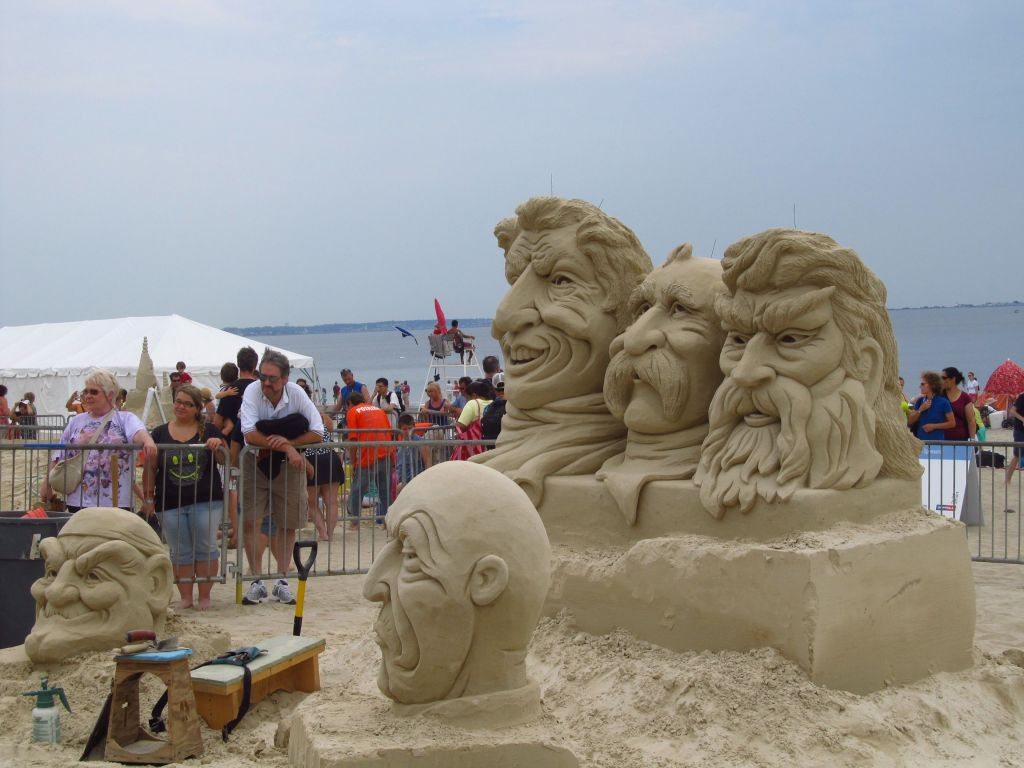 Heads made out of sand at Revere Beach