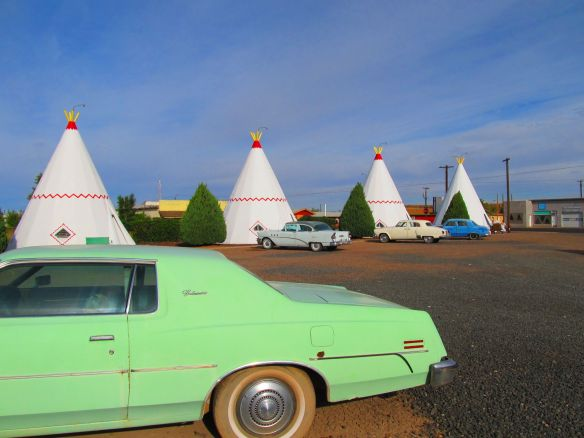 classic cars in front of the wigwam motel
