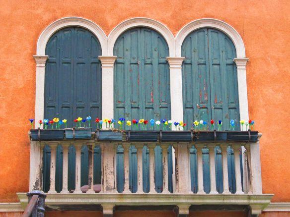 "Glass ""flowers"" on a Murano balcony"